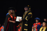 Receiving the Chancellor's medal