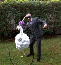Stick the rings in a piniata, blindfold the groom and let him work for it!  Hilarious!